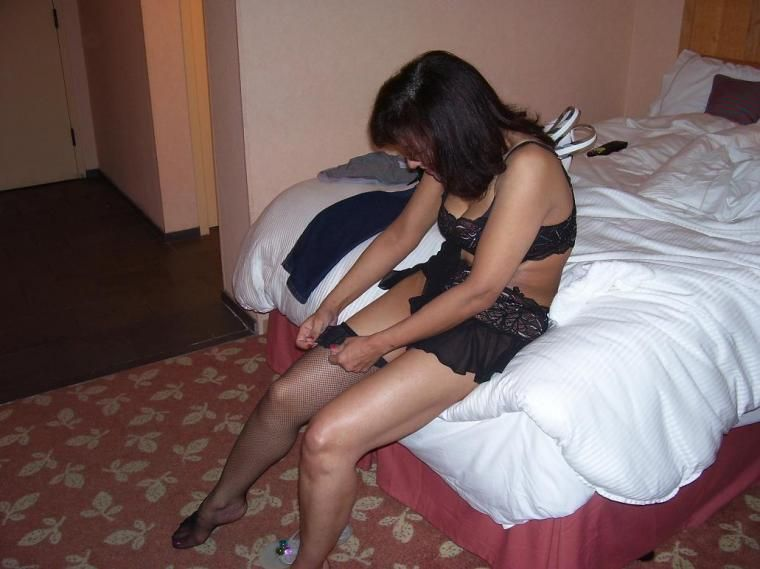 putting pantyhose Wife on
