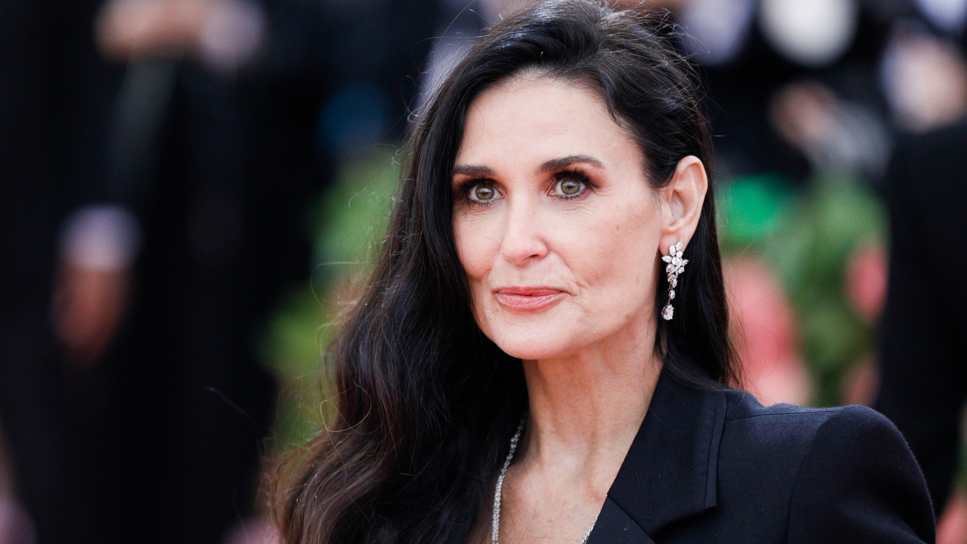 Why are demi moore boobs firm